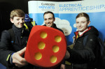 Careers Fest 2016. MINI Plant Oxford - 19/1/16 Throwing the dice with Clarkson Evans L-R, ED Davis, 14, from Larkmea School, Alex Pollard, Apprentice at Clarkson Evans and Luke Carter, 15, from Larkmead.